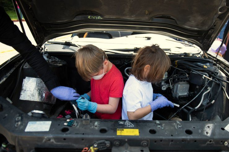 Calder Polaha, 6, left, and Raylan Jones, 5, disassemble a car at Tinkerfest at the Chabot Space and Science Center on April13, 2019 in Oakland, California. (Photo by Haley Nelson)